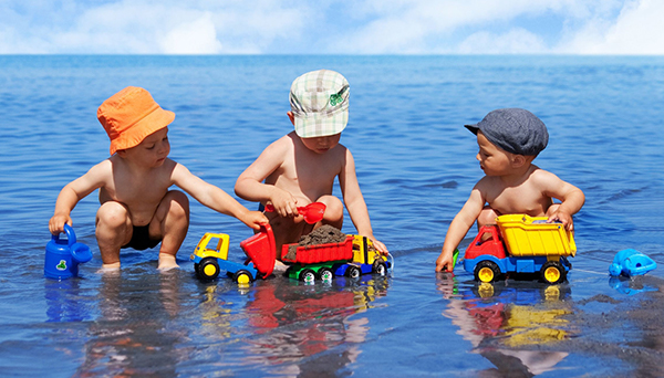 children in sea playing with plastic toys