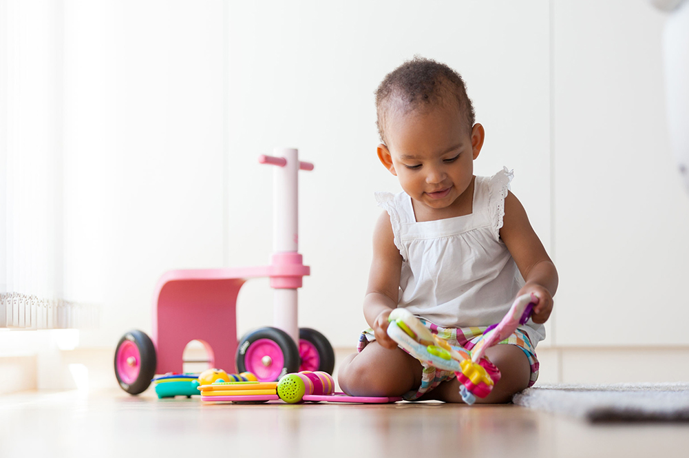 small child playing with plastic toys
